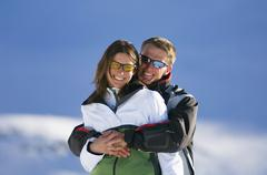 austria, salzburger land, couple embracing in mountains - stock photo