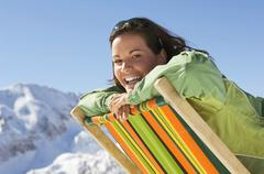 Woman in mountains sitting in deck chair Stock Photos