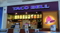 Taco Bell menu counter shopping mall Stock Footage