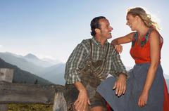 couple on mountain pasture, portrait - stock photo