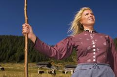 dairy maid holding crook - stock photo
