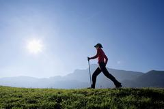 Woman exercising Nordic Walking, Austria, alps - stock photo