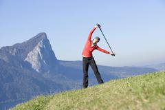 Woman exercising Nordic Walking, Austria, alps Stock Photos