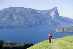 Stock Photo of Woman exercising Nordic Walking, Austria, alps