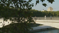 Preist crossing the Tiber river in Rome (slomo dolly) Stock Footage