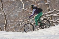 Germany, Bavaria, Kampenwand, Teenager mountainbiking - stock photo