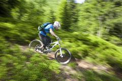 France, Porte du Soleil, Savoien, Mountainbiker riding bike speedy in funpark - stock photo