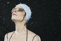 Woman with sunglasses standing in rain. Stock Photos