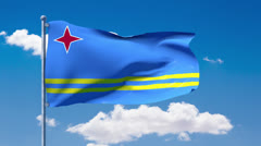 Aruban flag waving over a blue cloudy sky Stock Footage