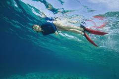 Croatia, Girl (6-7) snorkeling Stock Photos