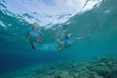 Croatia, Two girls (6-7) (10-11) snorkeling, portrait - stock photo