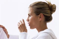 Woman drinking water, side view, close-up Stock Photos