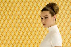Stock Photo of Young woman standing, close-up, side view