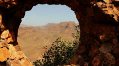 Dolly shot of hole in Wall with mountains in background, Gran Canaria, Spain Stock Footage