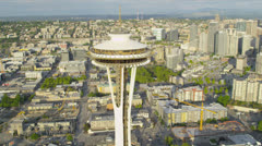 Aerial close up view Space Needle, Seattle residential suburbs Stock Footage