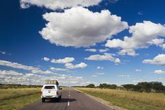 Africa, Botswana, Land vehicle passing through trans-kalahari highway - stock photo