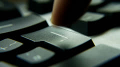 HD1080p50 Typing on a keyboard. Return Key. Close Up - stock footage