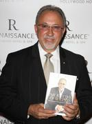 """Stock Photo of emilio estefan's book """"the rhythm of success"""" book signing cocktail party."""