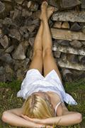 Austria, Salzburger Land, Altenmarkt-Zauchensee, Young woman relaxing - stock photo