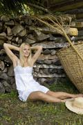 Austria, Salzburger Land, Altenmarkt-Zauchensee, Young woman relaxing - stock photo