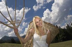 Stock Photo of Austria, Salzburger Land, Altenmarkt-Zauchensee, Young woman carrying basket