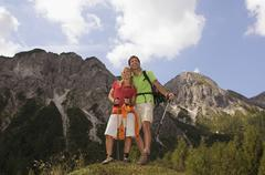 Austria, Salzburger Land, couple with walking sticks - stock photo