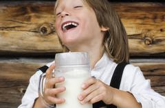 Austria, Salzburger Land,Boy (8-9) drinking milk, laughing, portrait Stock Photos