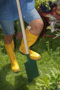 Austria, Salzburger Land, Person with spade, gardening - stock photo