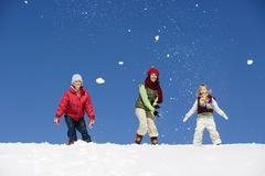 Austria, girls (6-17) playing in snow, low angle view - stock photo