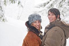 Austria, Salzburger Land, Altenmarkt, Young couple in snowy landscape, portrait Stock Photos