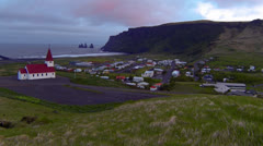 A church overlooks a small Iceland village. Stock Footage