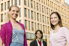 Young man and two young women, portrait Stock Photos