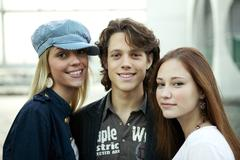 Young man with two young women, portrait Stock Photos