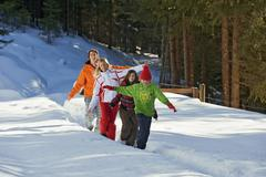 Austria, Salzburger Land, Altenmarkt, Family walking in snow - stock photo