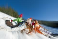 Austria, Salzburger Land, Altenmarkt, Family sledding - stock photo