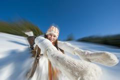Austria, Salzburger Land, Altenmarkt, Girl (10-11) sledding, portrait Stock Photos