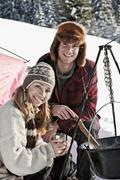 Austria, Salzburger Land, Couple cooking on campfire Stock Photos