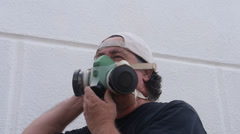 Painter - man puts gas mask Stock Footage