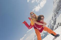 Austria, Salzburger Land, Couple having fun, man carrying woman, laughing - stock photo