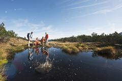 Austria, Salzburger Land, Hikers standing near lake Stock Photos