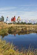 Austria, Salzburger Land, Four hikers in landscape - stock photo