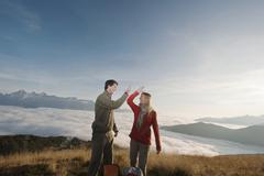 Austria, Steiermark, Reiteralm, Couple of hikers exchanging high-fives, Stock Photos