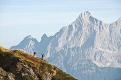 Austria, Steiermark, Reiteralm, Couple of hikers, side view - stock photo
