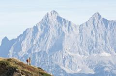 Austria, Steiermark, Reiteralm, Hikers in mountains - stock photo