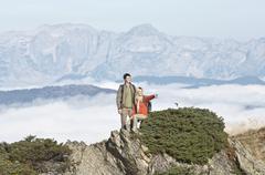 Austria, Steiermark, Reiteralm, Hikers in mountains, woman pointing - stock photo