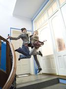 Two girls jumping on staircase Stock Photos
