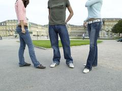 germany, stuttgart, young people standing in front of building, low section - stock photo