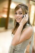 Young woman using mobile phone, portrait Stock Photos
