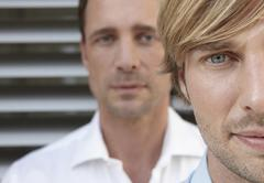 Stock Photo of Germany, Cologne, Two businessmen, staircase in background, portrait, close up