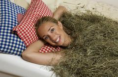 Stock Photo of Young woman, portrait, hay bath
